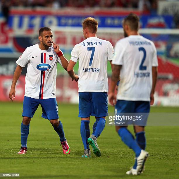 Smail Morabit Marc Schnatterer and Sebastian Heidinger of Heidenheim discuss during the Second Bundesliga match between 1 FC Heidenheim and 1 FC...