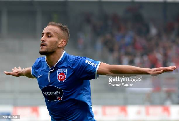 Smail Morabit of Heidenheim celebrates after scoring his teams opening goal during the third league match between SV Wehen Wiesbaden and 1FC...