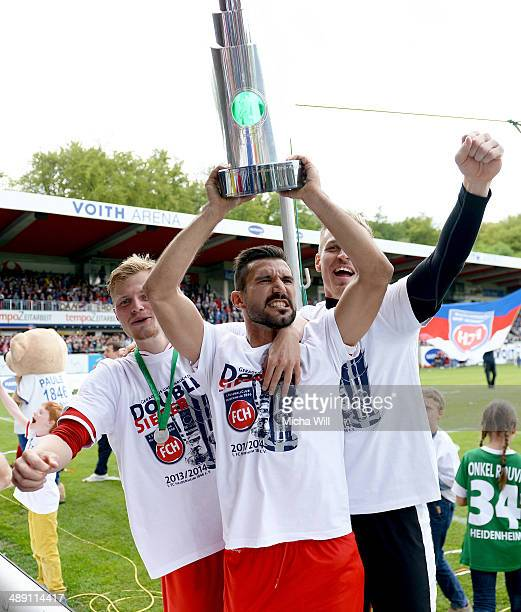 Smail Morabit of Heidenheim celebrates the championship title win of the Third League with teammates at VoithArena on May 10 2014 in Heidenheim...