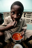 Small African Boy Eating Traditional Food