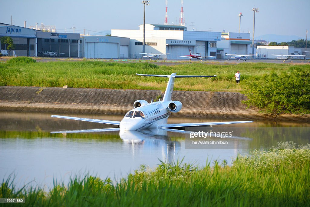 A small aircraft is seen in a pond after overrun at Konan Airport on June 10, 2015 in Okayama, Japan. The pilot was not injured.