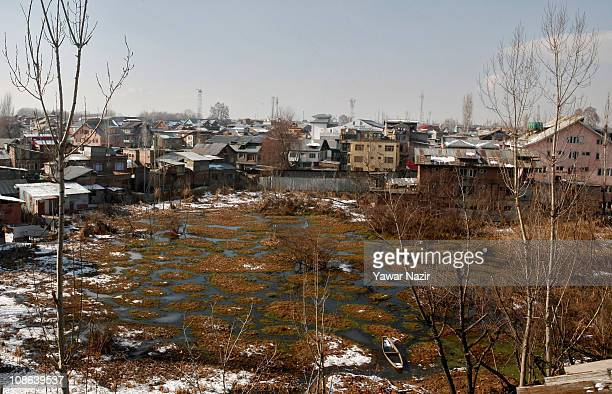 A small area of wetland is engulfed by the residential houses on January 31 2011 in Srinagar the summer capital of Indian administered Kashmir India...