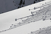 Small avalanches forming on the snow covered slopes