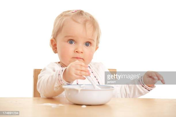 small baby girl eating