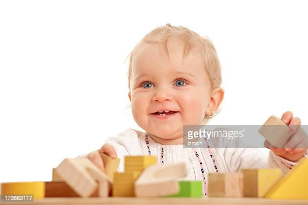 small baby girl with wooden blocks
