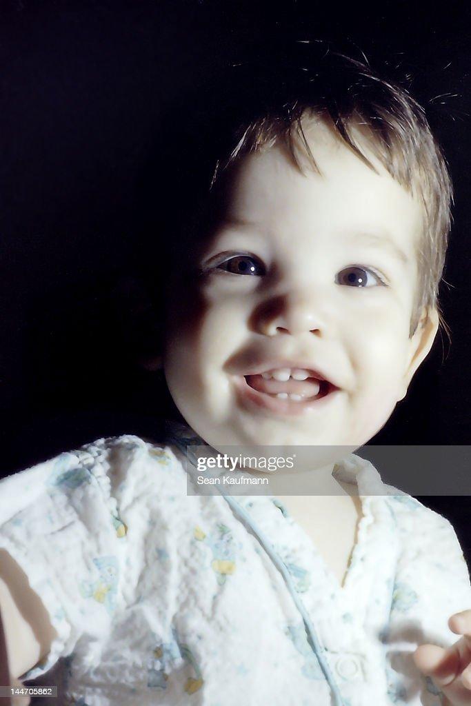 Small baby looking at camera : Stock Photo