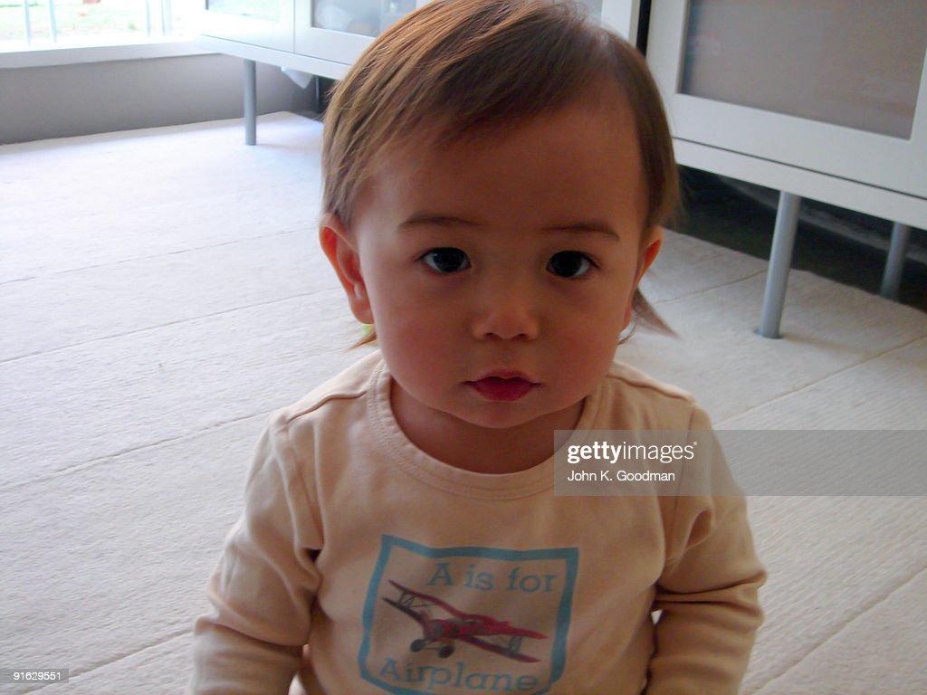 Small baby looks at the camera : Stock Photo