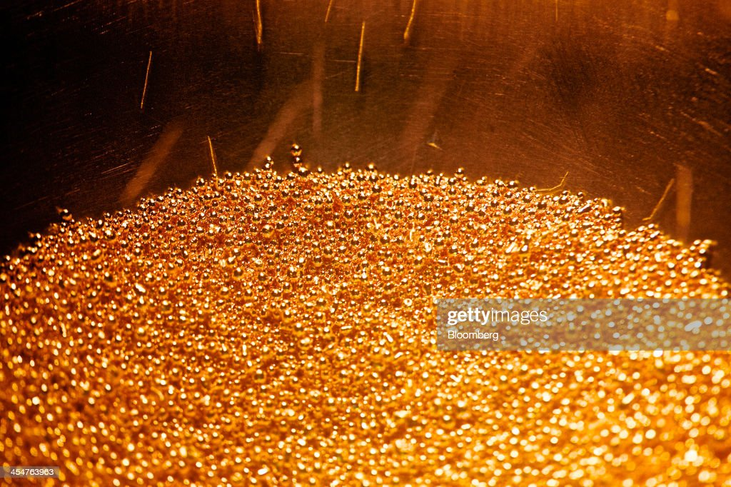 Small balls of solid gold are collected in a basin during the semiautomated gold manufacturing process at a precious metal refinery near Mendrisio...