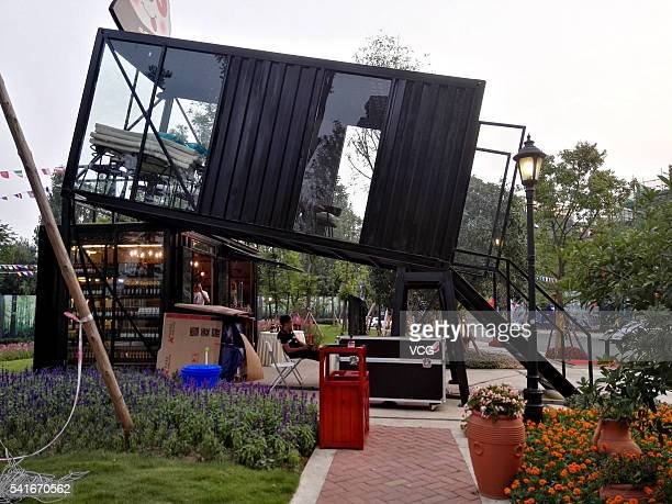 Small bar is built in slanted shipping container on June 19 2016 in Chengdu Sichuan province of China The bar is elevated from the ground and angled...