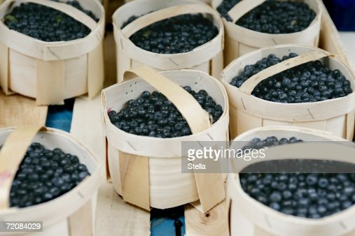 Small baskets of blueberries
