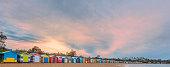 Long row of colorful beach huts and beautiful sunrise. Melbourne, Australia