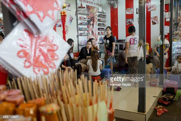 A small beauty salon is seen inside a market on April 8 2014 in Phnom Penh Cambodia The Cambodia beauty industry continues to grow aided by the...