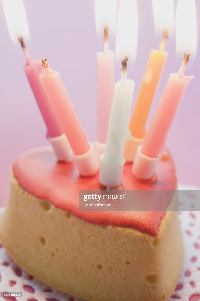 Small birthday cake with burning candles, close up : Stock Photo