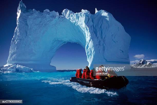 Small boat approaching icebergs near Yalour Islands, Antarctica.