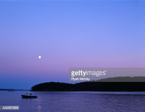 Small boat moored in harbor, sunset, San Juan Islands, Washington, USA