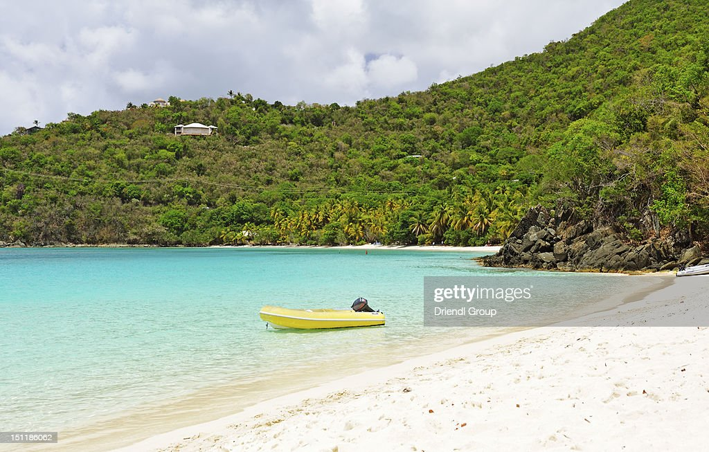 A small boat moored in Hawksnest Bay. : Stock Photo