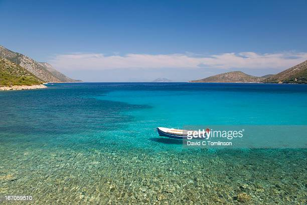 Small boat on turquoise sea, Vathy, Ithaca, Greece