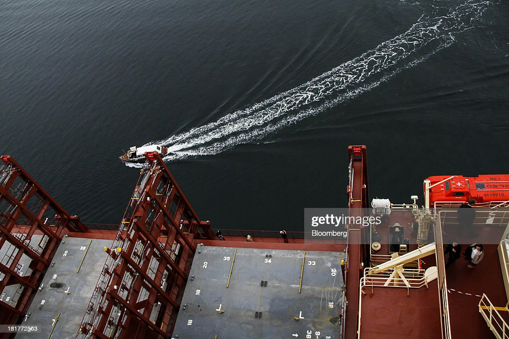 A small boat passes the Majestic Maersk Triple E class container ship, one of the world's largest vessels, operated by A.P. Moeller-Maersk A/S at Langelinie pier in Copenhagen, Denmark, on Tuesday, Sept. 24, 2013. A.P. Moeller-Maersk A/S says it won't cut its investment in developing markets from Asia to South America even as creditors turn their backs. Photographer: Freya Ingrid Morales/Bloomberg via Getty Images