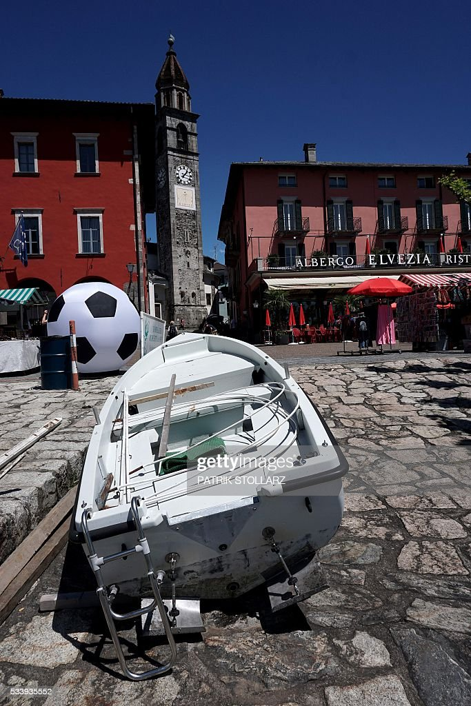 A small boat sits on the habour wall in the town of Ascona on Lago Maggiore also called Lake Langen on May 24, 2016. The German national football team will train here from May 24 until June 3, 2016 for the EURO 2016 taking place in France. / AFP / PATRIK