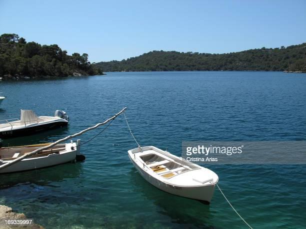 Small boats on the inland sea called Veliko Jezero within the National Park Mljet Island Croatia