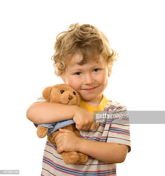Kleiner Junge mit seinem Teddybär