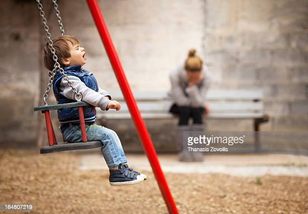 Small boy crying in a playground