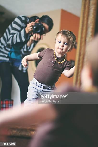 Small boy dancing in mirror