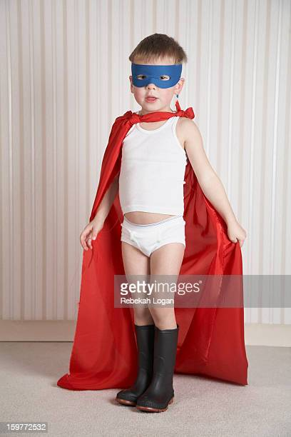 Small boy dressed up as superhero.