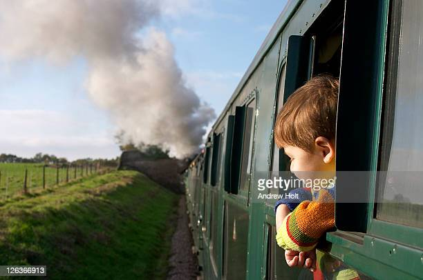 A small boy enjoying the view from a steam engine train on The Bluebell Railway in Sussex. The volunteer run Bluebell Line was the UK's first preserved standard gauge passenger railway, re-opening part of the Lewes to East Grinstead line of the old London
