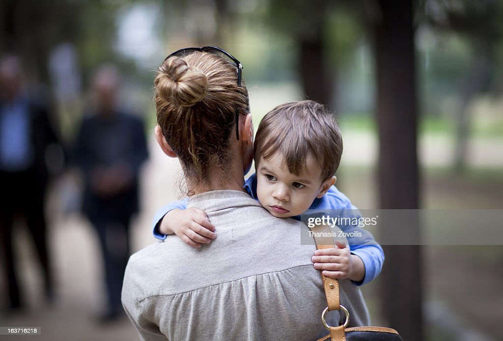 Small boy hanging his mother : Stock Photo