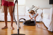 Small boy having fun with vacuum cleaner