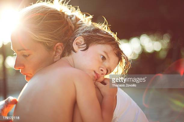Small boy hugging his mother