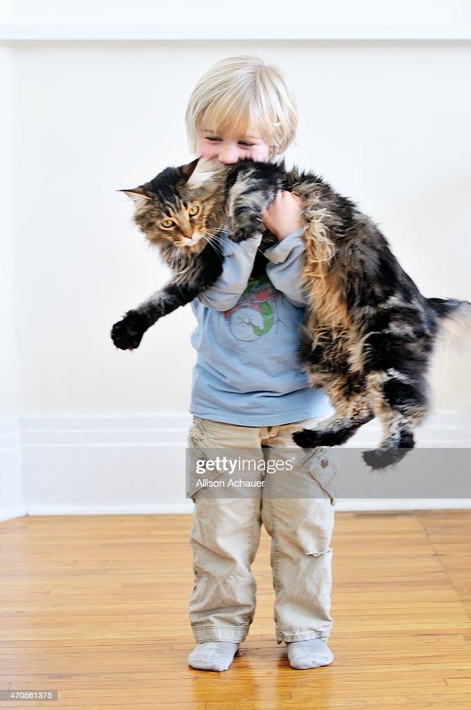 Small Boy, Large Cat : Stock Photo
