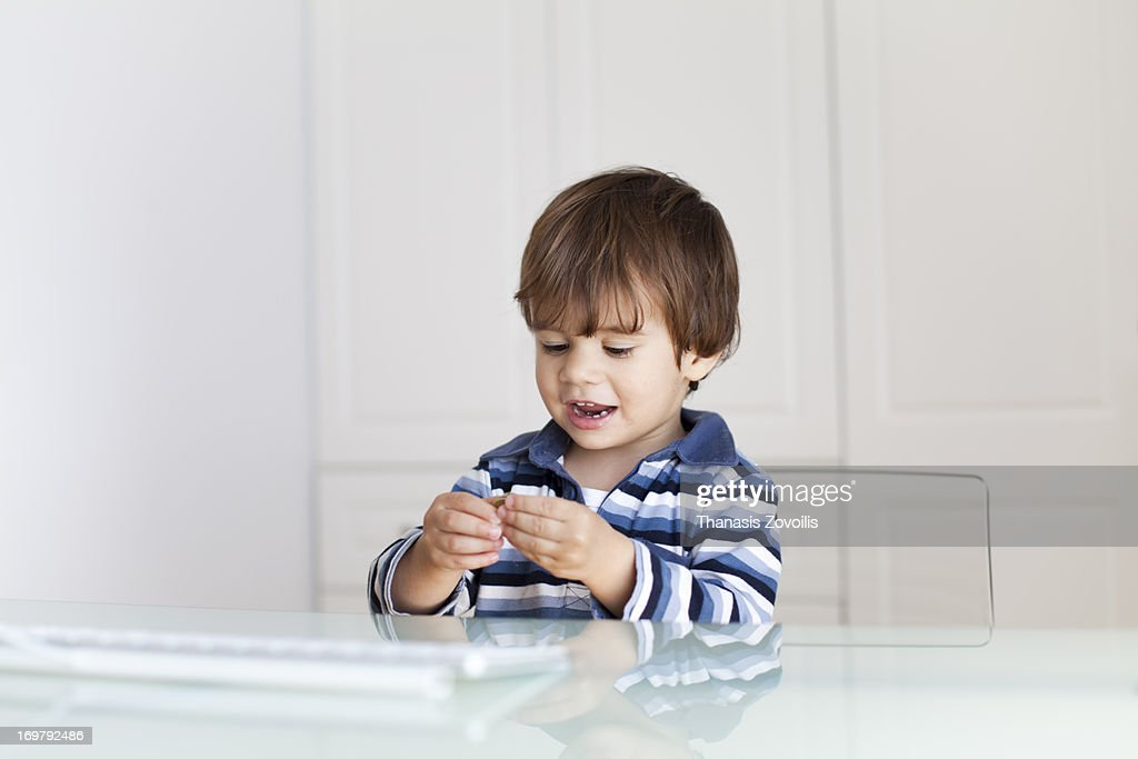 Small boy looking a coin : Stock Photo