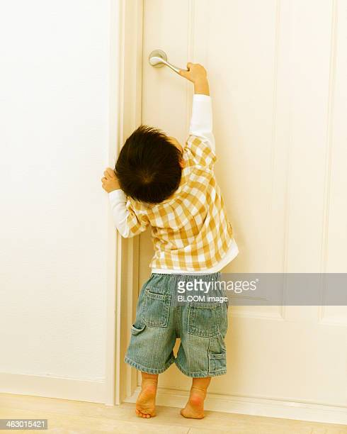 Small Boy Opening Door