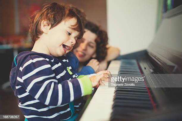 Small boy playing piano