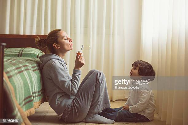 Small boy playing with his mother