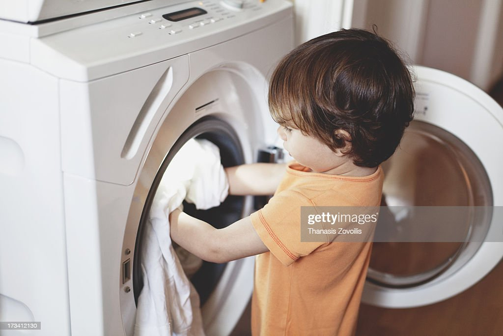 Small Boy Putting Clothes In A Washing Machine Stock Photo ... | 1024 x 683 jpeg 235kB