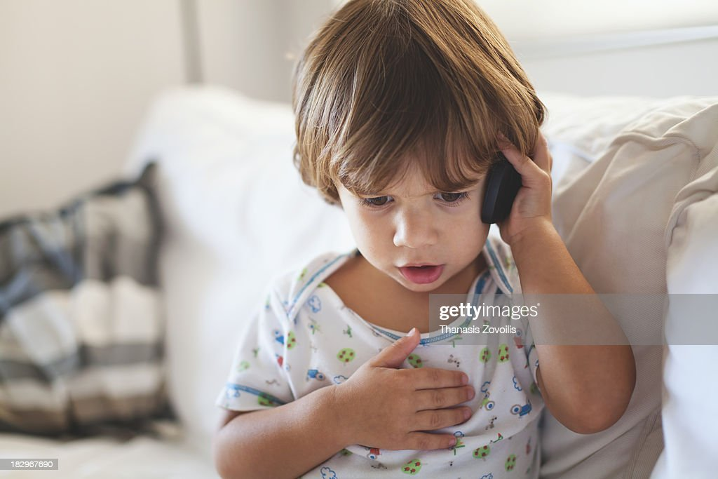 Small boy talking on mobile phone : Stock Photo