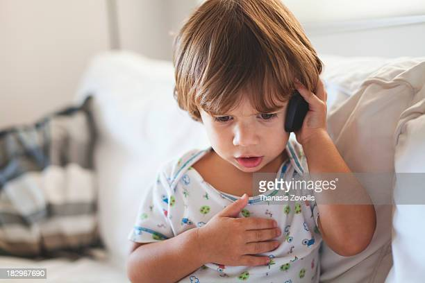 Small boy talking on mobile phone