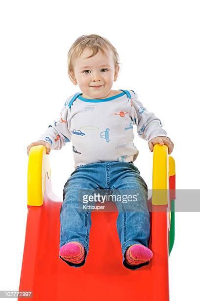 Small boy wallow on slide