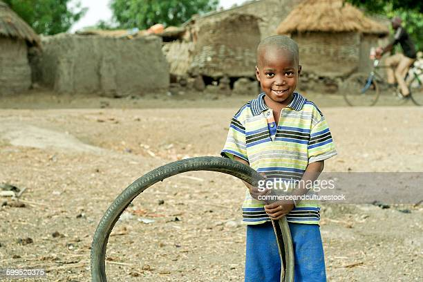 A small boy with a bicycle tire