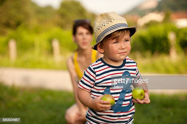 Small Boy with Green Apples