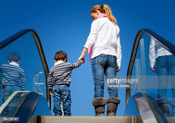 Small boy with his mother on a escalator