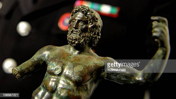 A small bronze statue of Zeus recovered by Rome's heritage police squad is displayed during a press conference after the announce that two statues...