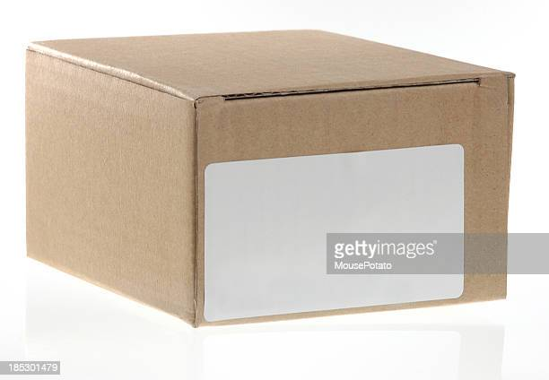 Small brown cardboard shipping box or carton with address label