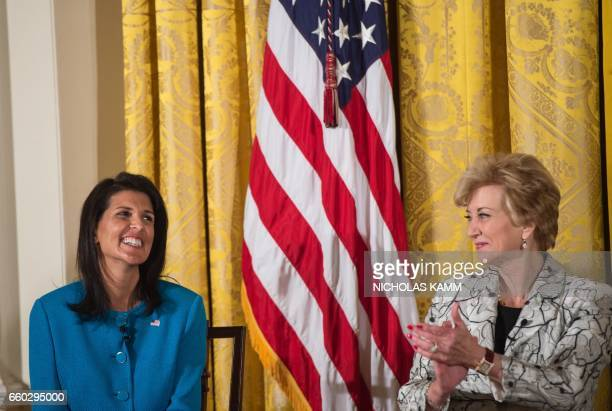 Small Business Administration head Linda McMahon applauds US Ambassador to the United Nations Nikki Haley as she is acknowledged by US President...