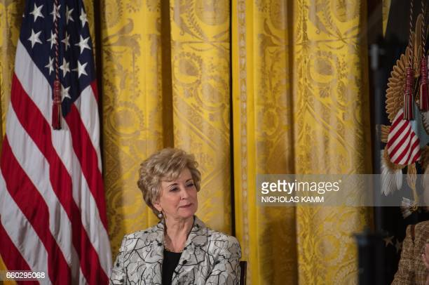 Small Business Administration head Linda McMahon listens to US President Donald Trump address the Womens Empowerment Panel in the East Room of the...