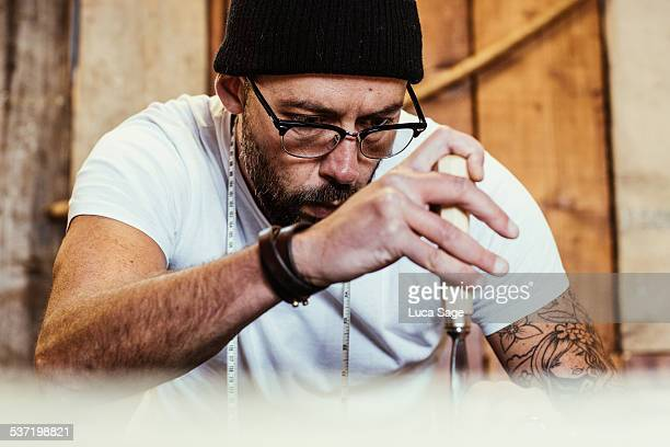 Small Business craftsman concentrating at work