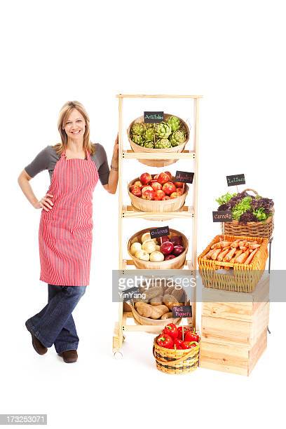 Small Business Grocery Store Owner with Produce on White